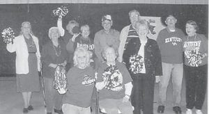 MARCH MADNESS — Celebrating the NCAA basketball tournament at Kingscreek were Vina Lucas, Lizzie M. Wright, Maxine Quillen, Coleen Hart, Ruby Caudill, Rhuford Hart, J.R. Kuracka, Lorraine Kuracka, Carl Parrott, Kathy Palumbo, and Lydia Hall.