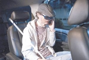 In this photo provided by Brigham and Women's Hospital, Dallas Wiens talked on his cell phone while en route for a full face transplant in Boston. (AP Photo)