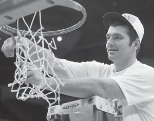 Kentucky's Josh Harrellson finished cutting down the net after the Wildcats defeated North Carolina in Newark, N.J., on Sunday. UK advances to play UConn in the Final Four this Saturday at 8:49 p.m. on CBS. (AP)