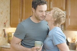 """Edie Falco (right) portrays Jackie Peyton and Dominic Fumusa portrays Kevin Peyton in the Showtime series, """"Nurse Jackie."""" (AP/Showtime)"""