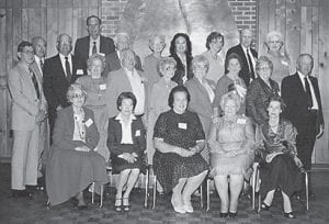 Members of the class of 1939 at their reunion in 1987 are (first row, left to right) Vivian Day Adams, Irene Blair Schopler, Irene Stamper Hughes, Agnes Sexton Crawford, Hazel Mullins Walters, (second row) Bill Kincer, Vashti Combs Riggle, Owen Sexton, Doris Adams Webb, Mable Jo Collins Buttrey, Mary E. Routley Kibbey, Mary Moncrief Webb, Charles Daugherty, (third row) Ted Cook, Wm. Fred Gibson, Mabel Holbrook Amburgey, Christine Profitt Eaves. Henrietta Frazier, Bruce Banks, Ruby Fields Prater, (fourth row) Dan Combs, and Oliver Rose.