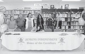 Pictured standing (left to right) are Jenkins Coach Ashley Addington, Rick Corbett, Pikeville Assistant Coach Teran Duncan, Karen Corbett , Pikeville Head Coach Bill Watson, and Pikeville Admissions Counselor Amber Collins. Seated is Sarah Corbett.