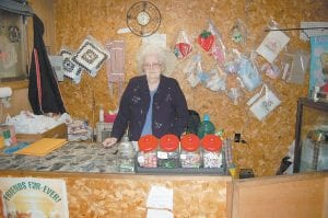Christine Whitaker stands behind a counter at Whitaker's Variety Store at Blackey. The rag sale is open from 8 a.m. until 3 p.m. on Tuesdays and Thursdays and from 1 until 4 p.m. on Saturdays and Sundays. (Photo by Sally Barto)