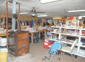 An old stove kept fired by Charlie Whitaker is located in the middle of Whitaker's Variety Store at Mayking. Christine Whitaker has been selling gently-used clothing, toys and household items at extremely low prices for 42 years. (Photo by Sally Barto)