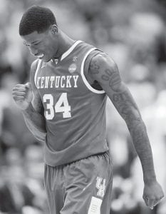 Kentucky's DeAndre Liggins reacted happily after making a defensive stop in Sunday's Elite Eight win over North Carolina. (AP)