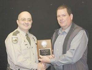 Conservation Office Homer Pigman has been named 7th District Officer of the Year. The award was presented by Sgt. Charlie Phillips.
