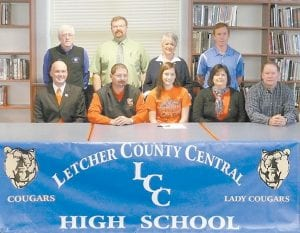 Annreyn Campbell, a senior at Letcher County Central High School, signed to play with the Pikeville College women's golf team. She is the first LCCHS student to sign to play golf with a college. She is the daughter of Frank and Debbie Campbell of Blackey. Pictured are (bottom left to right) Pikeville College Director of Admissions Gary Justice, Pikeville Golf Coach Nelson Scott, Annreyn Campbell, Debbie Campbell, Frank Campbell, (top) LCCHS Athletic Director Ozz Jackson, LCCHS Principal Stephen Boggs, Lady Cougar Golf Coach Bobbi Whitaker and LCCHS Golf Coach Brett Richards.