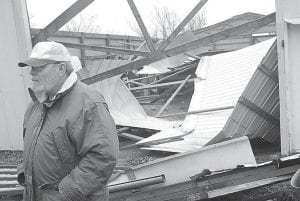 Steve Sharp stood outside the large storage building behind his home on Kelley Road near Heath in western McCracken County near Paducah on Monday. The building lost its roof Monday morning when what is believed to be a severe thunderstorm struck the area. (AP Photo/The Paducah Sun)