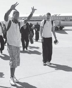 WELCOMED HOME — Kentucky basketball players DeAndre Liggins, left, and Eloy Vargas approached fans at Bluegrass Airport after returning to Lexington on Sunday after losing to Connecticut in the semifinals of the NCAA Final Four. (AP Photo/James Crisp)