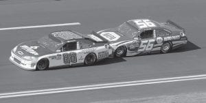 In this file photo, Dale Earnhardt Jr. (88) and Martin Truex Jr. (56) teamed up during the Daytona 500 NASCAR auto race at Daytona International Speedway in Daytona Beach, Fla. Two-car tandems took over the season-opening Daytona 500, where the huge pack of cars broke apart as drivers realized that the fastest way around the superspeedway was with just one partner. Two drivers hooked up, took turns pushing each other to the front, then swapped the lead when their engines got too hot from all that pushing. Many fans fear a repeat of that racing at Talladega, and by every indication, that's exactly what they'll see. (AP Photo)