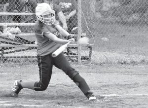 Jenkins sophomore Randee Phillips connected with a thirdinning triple in the Lady Cavs' 12-2 win over Harlan County on Monday. Phillips was 2-4 on the day, also garnering a single and two stolen bases late in the game. The Lady Cavs improved to 5-3 on the season as they seek to defend their 14th Region title. (Photo by Chris Anderson)