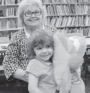 Three-year-old Arrora Hayes of Blackey, was a recent visitor to the Blackey Public Library. She is pictured with Librarian Bonnie Asher, with whom she enjoyed children's stories.