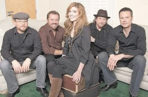 Alison Krauss, center, poses with Union Station, from left, Ron Block, Dan Tyminski, Krauss, Jerry Douglas, and Barry Bales. (AP Photo)