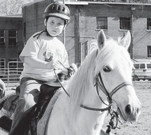 Bailey Couch is the son of Alana and Michael Couch of Jeremiah. He is the grandson of Allen and Sylvania Whitaker of Jeremiah, and Leo and Judy Couch of Bus. He is pictured riding Peter, a four-year-old gelding. Peter is a quarter horse/racking horse mix, which stands at 14 hands tall, from Revelation Ranch.