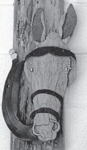 Virginia Brown received a special gift from Darrell Boggs for her 92nd birthday, a mule carved from a log from his grandfather George Sturgill's barn, which was built in the last century. Before it was used in the barn, the log had been in the home of Stephen Adams, Mrs. Brown's grandfather, built in the 19th century. Years ago the Stephen Adams home was pictured in The Mountain Eagle along with the rip saw that was used to build it. This house was replaced by Hop Gibson with the one Mrs. Brown still lives in.
