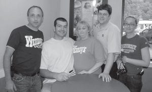 Pictured from left are Billy King, district manager of Wendy's, Josh Harrellson, Felicia Potter, an employee of Neighborhood Restaurants, Scott Helle, general manager of the Whitesburg Wendy's and Marie Tackett, co-manager of the Whitesburg Wendy's.