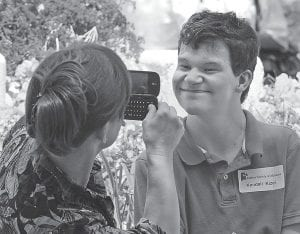 Debbie Kizer, left, of Huntsville, Ala., took a photo of her autistic son Kendall, 17, after the rally for people with Autism Spectrum Disorders recently, at the Alabama State House in Montgomery, Ala. (AP Photo/Montgomery Advertiser)