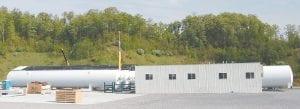 Six large storage tanks can each hold 5 million standard cubic feet of liquid nitrogen.