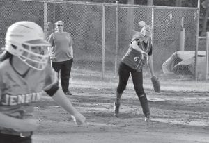 Letcher Central third baseman Micca Boggs fired across the diamond to retire Jenkins's Mercedes Boggs in softball action last week. The Lady Cougars fell to the Lady Cavs 4-1, but Letcher Central rebounded with a big win over Cordia on Monday to pull to 10-10 on the season.