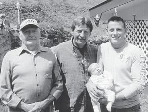 Pictured are great-grandfather Glenn Miles of Big Cowan, grandfather Gary Miles of Georgetown, and father Neil Miles holding his son Braiden Miles. Neil Miles is stationed at Camp Lejeune, N.C., with the U.S. Marine Corps. He and his father, Gary Miles, were visiting with Glenn and Dorothy Miles for Easter and helping the couple celebrate their 57th wedding anniversary.