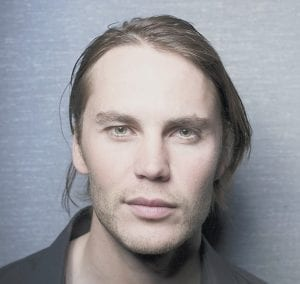 """Actor Taylor Kitsch posesd for a portrait in New York recently. Kitsch portrays South African war photographer Kevin Carter in the film, """"The Bang Bang Club."""" (AP)"""