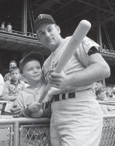 This Sept. 12, 1964 photo shows Minnesota Twins' Harmon Killebrew posing with 9-year-old Johnny Guiney, at New Yorks Yankee Stadium. Killebrew had visited Guiney in May after he was hospitalized with critical burns suffered when his altar boy robes caught fire. Johnny asked his idol to hit a homer, and the leading home run hitter in the major leagues responded with a first inning, two-run blast. Killebrew, the Twins slugger known for his tape-measure home runs, died Tuesday at his home in Scottsdale, Ariz. He was 74. (AP Photo)
