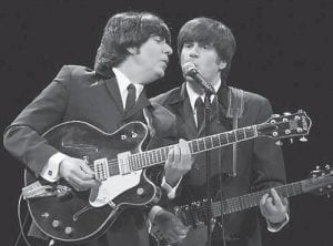 Joe Bithorn and Steve Landes impersonate two of The Beatles in the Broadway production 'Rain.'