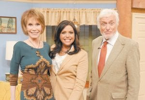 """Mary Tyler Moore, left, host Rachael Ray, center, and Dick Van Dyke posed during a recently taping of """"The Rachael Ray Show"""" in New York. Moore and Van Dyke, co-stars from the 1960s comedy series, """"The Dick Van Dyke Show,"""" reunited on Ray's daytime show on May 12. Van Dyke is promoting his memoir, """"My Lucky Life In and Out of Show Business."""""""