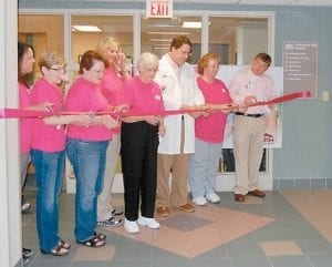 A RIBBON-CUTTING CEREMONY was held May 20 at Whitesburg hospital for new digital mammography equipment. Pictured from left are Donna Collins, a mammography technician; Monica Bentley, a breast cancer survivor; Henrietta Wright, a breast cancer survivor; Tonya Aslinger, a mammography technician; Billy Lois Adams, a breast cancer survivor; Dr. Robert Buck, radiologist; Alice Lucas, director of radiology; and Brandon Cornett, assistant administrator.