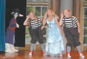 "Tori Ison (left) played the white rabbit in Whitesburg Middle School's version of the play ""Alice in Wonderland."" Kennedy Breeding was Tweedledee, Sara Baker was Alice, and Cassidy Breeding was Tweedledum."