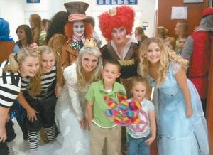 "Braydon Burton and his sister Jade Burton posed for a photo with members of the ""Alice in Wonderland"" cast on May 23 at Letcher County Central High School. Pictured from left are Cassidy Breeding as Tweedledum; Kennedy Breeding as Tweedledee; Ashley Benton as the White Queen; Abby Frazier as the Mad Hatter; Braydon Burton; Jade Burton; Kelly Adams as the Red Queen; and Sara Baker as Alice."