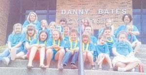 Lisa Bates's second grade class at Letcher Elementary School collected the most box tops for education during the 2010-2011 school year. The school trades in the box tops for educational materials. The class was given an luau party by the LES Parent Teachers Organization. Pictured are (front row, left to right) Summer Madden, Makenzie Holmes, Alex Pardo, Alyssa Martin, Ethan Howard, Kadence Whitaker, (middle row) Karrie Eldridge, Shaelyn Jent, Alex Whitaker, Trenton Sizemore, Gage Caudill, Joey Finnigan, (top row) Lisa Bates, Madison Caudill, Ava Fisher, Addison Smith, Faith Back, Krisey Slone, and Frankie Martin.