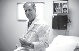 """Dr. Nicholas DiNubile at his office in Havertown Pa. DiNubile, an adviser to several pro athletic groups and a spokesman for the American Academy of Orthopaedic Surgeons, says """"The boomers are the first generation trying to stay active in droves on an aging frame"""" and are less willing to use a cane or put up with pain or stiffness as their grandparents did. (AP Photo/Matt Rourke)"""