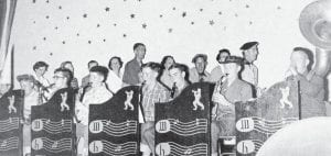Ed Cornett was a member of Mr. Taylor's orchestra and dance band. Pictured are (left to right) Jack Taylor, Gail Potter, Bert Francis, John Lynn Rice, Johnny Doyle, Eddie Cornett, Don Hughes and R. T. Holbrook. On the back row, doing the Bunny Hop are Nazaretta Price, Lucy Fields, Dot Webb, Follace Fields, Clova Setzer, Ralph 'Snake' Frazier, Peggy Hidvegi and Coach Ed Moore.