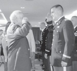 Wesley Yonts, commissioned a first lieutenant May 13 at Morehead State University, receives his first salute from his grandfather, Duane Yonts of Little Cowan, a former Army non-commissioned officer. Wesley Yonts was graduated from MSU May 14 with a degree in history. He lives in Dahlonega, Ga., and is the son of former Letcher County resident Roger Yonts. After his officer basic course, he will assume his first duty assignment with the 4th BDE Combat Team, 25th Infantry Division at Fort Richardson, Alaska, as a Medical Service Corps officer.