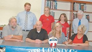 Letcher County Central High School senior Lisa Frazier signed scholarship papers on May 24 to play volleyball for the University of Virginia at Wise. Pictured are (front row, from left) LCCHS Volleyball Coach Dickie Adams, her father Gaither Frazier, Lisa Frazier, her mother Debbie Frazier, (back row) LCCHS Principal Stephen Boggs, University of Virginia at Wise Assistant Coach Kristin Salyers, University of Virginia at Wise Coach Head Coach Kendall Rainey and Letcher Athletic Director Oz Jackson. (Photo by Dianna Holbrook)