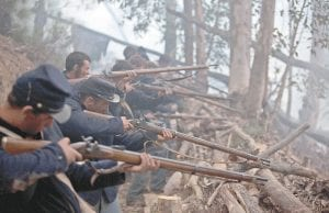 """A History Channel photo shows a scene depicting Union soldiers on Culp's Hill firing down on advancing Confederate troops during the TV documentary """"Gettysburg"""" that was filmed in Western Cape, South Africa. """"Gettysburg"""" airs again Thursday at 9 p.m. (AP Photo)"""