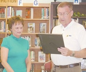 The Jenkins Independent has named Anita Bolt the Outstanding Teacher of the Year for the 2010-2011 school year. Bolt has taught for 25 years in the Jenkins School System and is the kindergarten teacher at the Burdine Campus. She is pictured with Board Chairman Durward Narramore.