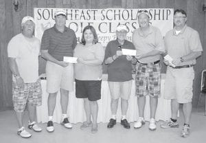 The Tri-State Mining Cable golf team captured first place in the Faye Simpson Southeast Scholarship Golf Classic held June 4 at Sleepy Hollow Golf Course at Cumberland. Pictured are (left to right) Bobby Warf, Eddie Leisge, event coordinator Tiffany Scott, SKCTC President W. Bruce Ayers, Mark Lowe and Joe Eldridge. The event benefits the SKCTC scholarship fund.