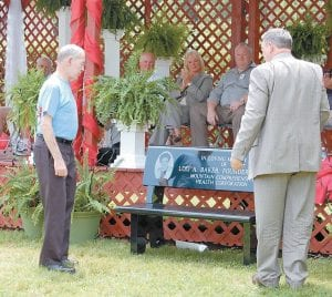 "Former Whitesburg Mayor Nathan Baker and L.M. ""Mike"" Caudill looked at a bench memorializing the late Lois A. Baker, who served as chief executive officer of MCHC for more than 30 years. Mrs. Baker was the wife of Nathan Baker and the mother of Mike Caudill."