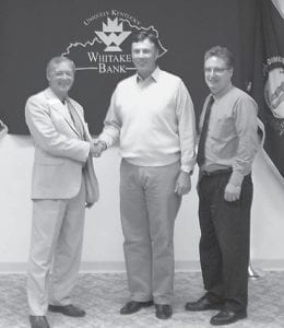 SENATOR BRANDON SMITH attended a business development meeting held by Whitaker Bank, and discussed his recent trip to China with bank board members and staff. He said he had seen ways China has implemented technology developed in Kentucky to get clean energy from coal. Pictured are (left to right) Whitaker Bank Area President Paul Adams, Sen. Smith, and Whitaker Bank Regional Manager Larry Adams.