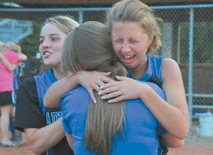 Letcher County Central High School softball player Madison Stump was so happy she cried after Emotions the Lady Cougars upset Powell County to win the 14th Region Softball Tournament at Estill County High School in Irvine and advance to the KHSAA Girls' State Tournament in Owensboro, where they will play Louisville Ballard on Thursday. The 3-2 upset came after the Lady Cougars finished as runners-up in the 53rd District Tournament to the Jenkins Lady Cavaliers, then went on to beat regional favorite Estill County, 6-3, and Leslie County, 14-4. Pictured at left is Kristen Phelps. (Photo by Chris Anderson)