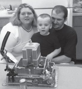 Xavier William Benjamin Cornett turned three years old nearly three months ago. He is pictured here with his parents, Lonnie (Ben) and Ashley Turner Cornett, celebrating his most recent birthday at a party held in his honor at their home in Cumberland on February 15. His grandparents are Dave and Dorcus Turner and Mary Eldridge, all of Cumberland, and Lonnie and Deborah Boggs Pack of Kingscreek.