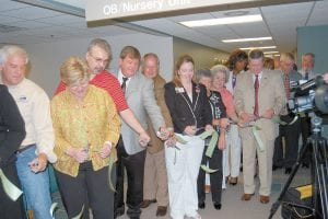 Pictured cutting ribbon for the new 15,000-square-foot addition to the Whitesburg Appalachian Regional Healthcare hospital are Magistrate Bobby Ray Howard, Debbie Hogg, Dr. Wade Baker, Letcher County Judge/Executive Jim Ward, ARH Board of Trustees Chairman Russell Bentley, Whitesburg ARH Community Chief Executive Officer Dena C. Sparkman, Peggy Childers, Danna Richardson, ARH Board of Trustees Member Caroline Sundy and ARH President and Chief Executive Officer Jerry W. Haynes.