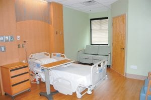 Seen above is a new private room in the new addition which includes space for surgery, postpartum, obstetrics and nursery.