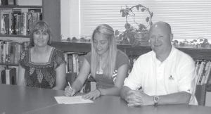 Micca Boggs, pictured at center, signed scholarship papers on June 3 to play softball at the University of Pikeville. Pictured with Micca are her mother, Michelle Boggs, and University of Pikeville Head Coach Robert Staggs. Micca's father is Fritz Boggs. (Photo by Sally Barto)