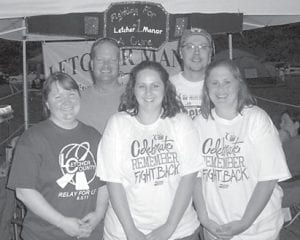 Letcher Manor has raised almost $4,000 to benefit the American Cancer Society. They joined the Letcher County Relay for Life event June 3 at Riverside Park. Pictured are (left to right) Goldie Baker, Ronnie Workman, Tamara Eldridge, Scotty Caudill and Aimee Perry.