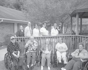 RESIDENTS AND STAFF of Letcher Manor participated in an eight-county balloon release on June 15 in honor of World Elder Abuse Awareness Day. Pictured are (standing, left to right) Gretta Fields; Scotty Caudill, social worker; Angela Halcomb, MDS coordinator; Diana Sexton, director of nursing; Gwen Lumpkins, MDS coordinator; (seated) Richard Corbett, Bill Wells, Irene Houston, Linda Johnson, and Alice Kincer.