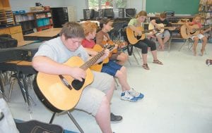 Pictured from left are Cowan Creek Mountain Music School students Austin Profitt, Joseph Collum, Zoey Parker, Kathleen Perry, Shannon Godsey and Madison Baker.