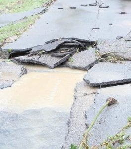 Carla Smith took this photo of road damage caused by ravaging waters at Little Cowan Monday afternoon after a flash flood hit the community.